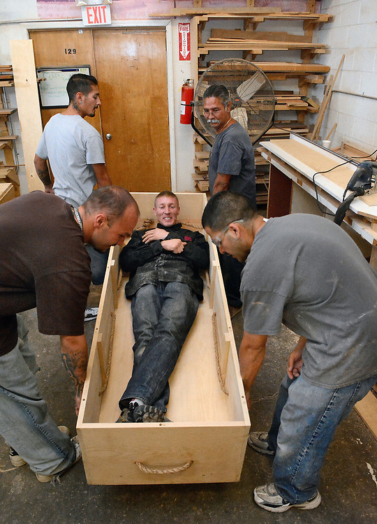 jt070717e/ a sec/jim thompson/Alfredo Baca test out the Kosher casket as other members of the group pick it up and listen for sounds that might alarm them that it is not built right.  Friday,  July. 07, 2017. (Jim Thompson/Albuquerque Journal)