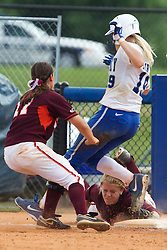 UK first baseman Lauren Cumbess, right, beats a diving attempt by Virginia Tech catcher Courtney Liddle to make the tag in the 5th inning. ..The University of Kentucky Softball team hosted Virginia Tech in KY Regional Championship Game of the 2013 NCAA D1 Softball Tournament, Sunday, May 19, 2013 at John Cropp Stadium in Lexington. Photo by Jonathan Palmer