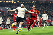 Manchester United defender Harry Maguire (5) clears the danger from Liverpool forward Roberto Firmino (9) during the Premier League match between Liverpool and Manchester United at Anfield, Liverpool, England on 19 January 2020.