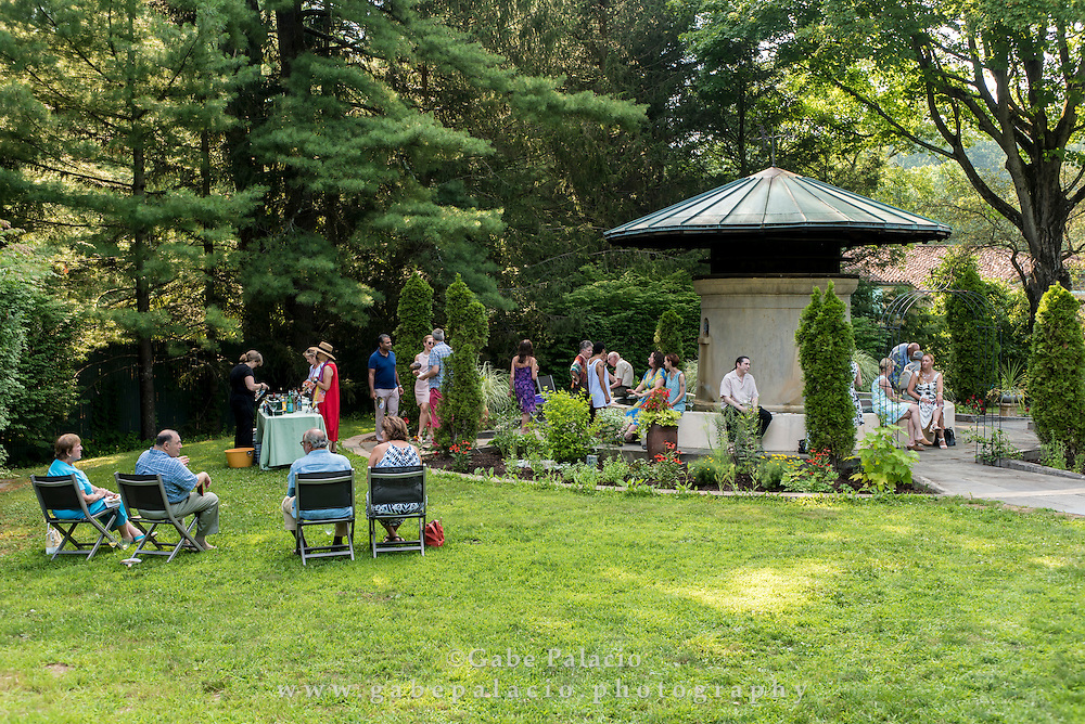 A cocktail party around the Sense Circle at Caramoor in Katonah New York on July 22, 2016. <br /> (photo by Gabe Palacio)