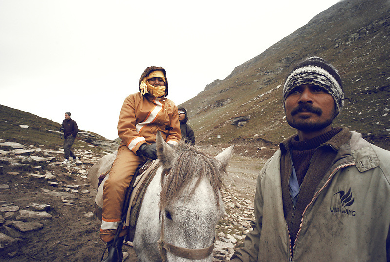 An Indian tourist is guided on a horse ride along the Sissu mountain pass Rohtang Lah Valley, Himachal Pradesh, India on Sep. 9, 2007. Many Indian tourists visit this spot for their first exeprience of snow. .