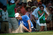 TIGER WOODS hits out of the greenside bunker on the sixth hole at Congressional CC in Bethesda, MD. during the second round of the AT&T National. Woods shot a 3-under 68  to be within 3 shots of the lead with others still on the course.