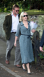 © London News Pictures. 21/04/2014 . Davington, UK. MARRIELLA FOSTRUP and husband JASON McCUE. The Funeral of Peaches Geldof. at St Mary Magdalene and St Lawrence Church in the village of Davington, Kent. Peaches Geldof, daughter of Irish singer-songwriter and political activist Bob Geldof, died on Apr. 7 at her home in southeastern England. Her death still remains unexplained.  Photo credit : Ben Cawthra/LNP