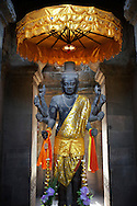 A religious deity greets visitors at the entrance of the Angkor Wat temple in Siem Reap, Cambodia.