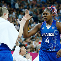 09 August 2012: France Isabelle Yacoubou is congratulated by France Florence Lepron during 81-64 Team France victory over Team Russia, during the women's basketball semi-finals, at the 02 Arena, in London, Great Britain.