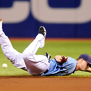 Rays' shortstop Reid Brignac can't reach a ground ball hit by Red Sox Adrian Gonzalez during the first inning Sunday, July 17, 2011 in St. Petersburg.