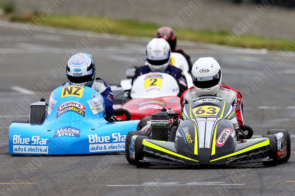 Mason Armstrong, 63, Gareth Playle, NZ, Lochlan Miller, 2, and Derek Lawrence, 61, race in the Rotax Light class during the 2012 Superkart National Champs and Grand Prix at Manfeild in Feilding, New Zealand on Saturday, 7 January 2011. Credit: Hagen Hopkins.