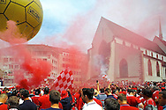 Liverpool fans enjoy the atmosphere in a city square in Basel pictured ahead of the UEFA Europa League Final at St. Jakob-Park, Basel<br /> Picture by Kristian Kane/Focus Images Ltd 07814482222<br /> 18/05/2016