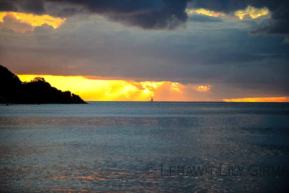 The sun sets across Grande Anse Beach, on Basse-Terre - Guadeloupe Islands.