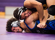Xavier Mascareñas/Treasure Coast Newspapers; Fort Pierce Central's Zaine Parlor (top) presses Wellington's Angelo Tizol to the mat as they wrestle in the night's final 152-pound match Thursday, Jan. 11, 2018, at Fort Pierce Central High School. Royal Palm Beach and Jupiter were eliminated earlier in the meet as the teams vied for one of the Region 3 berths in Class 3A at the inaugural Florida High School Dual Wrestling State Championships next week.