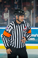 KELOWNA, CANADA - OCTOBER 5:  Referee Chris Crich stands on the ice at the Kelowna Rockets against the Victoria Royals on October 5, 2018 at Prospera Place in Kelowna, British Columbia, Canada.  (Photo by Marissa Baecker/Shoot the Breeze)  *** Local Caption ***