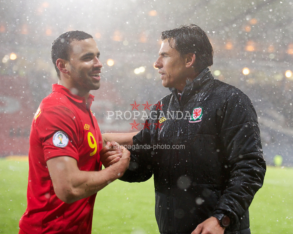 GLASGOW, SCOTLAND - Friday, March 22, 2013: Wales' manager Chris Coleman and winning goal-scorer Hal Robson-Kanu after the 2-1 victory over Scotland during the 2014 FIFA World Cup Brazil Qualifying Group A match at Hampden Park. (Pic by David Rawcliffe/Propaganda)
