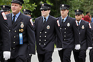 Salisbury Mills, New York - Members of the Salisbury Mills Fire Department march down Route 94 during the Orange County Volunteer Firemen's Association (OCVFA) annual parade on Sept. 24, 2011.