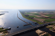 Nederland, Flevoland-Overijssel, Ramspol, 01-05-2013; Balgstuw met strekdam en de vaargeul in het Ramsdiep,rechts Flevoland. <br /> Ramspol, inflatable dike, between Ketelmeer and Black Water. The Balgstuw (bellow barrier) is a storm barrier and consists of an inflatable dam or dyke, composed of three bellows. Usually, each bellow rests on the bottom of the water, but now the bellows are inflated  because of maintenance.<br /> luchtfoto (toeslag op standard tarieven)<br /> aerial photo (additional fee required)<br /> copyright foto/photo Siebe Swart