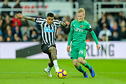 Will Hughes (#19) of Watford defends the ball against Kenedy (#15) of Newcastle United during the Premier League match between Newcastle United and Watford at St. James's Park, Newcastle, England on 3 November 2018.