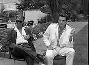 "Sade and Tony Hadley Interviews.  P92..1984.21.08.1984..08.21.1984..21st August 1984..As part of his interview sessions for ""Video File"" for R.T.E., Marty Whelan interviewed international music stars. The interviews were held in the R.T.E.,studios and at various hotels throughout the city...Gary Kemp and Tony Hadley are pictured in the gardens of Jury's Hotel in Ballsbridge for their interview with Marty Whelan."