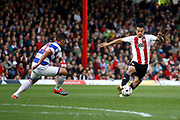 Brentford defender Nico Yennaris (8) looks to take on Queens Park Rangers midfielder Massimo Luongo (21) during the EFL Sky Bet Championship match between Brentford and Queens Park Rangers at Griffin Park, London, England on 22 April 2017. Photo by Andy Walter.