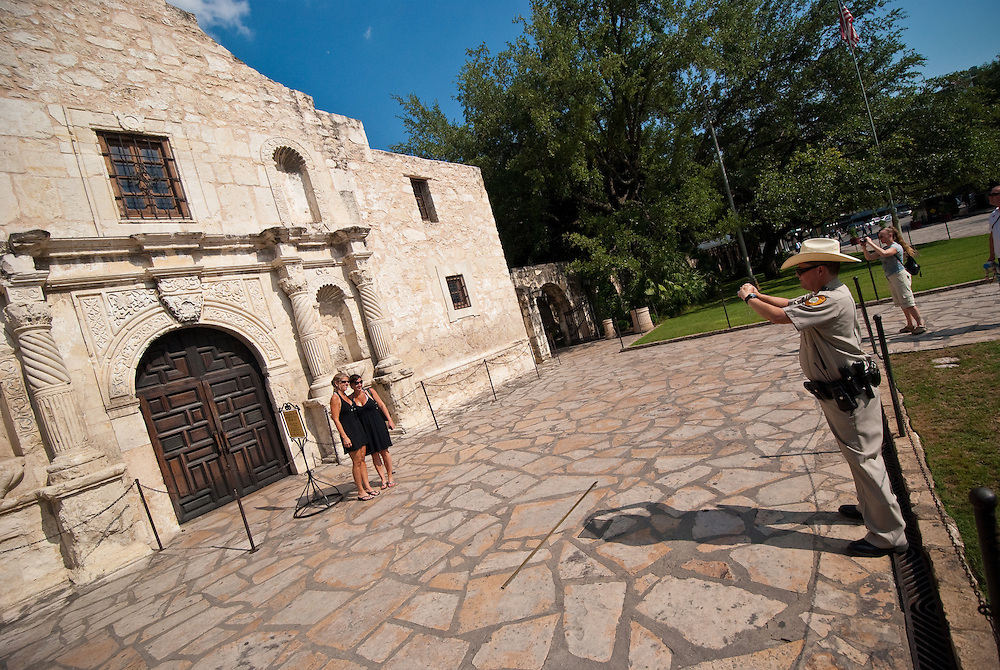 Police Officer Photographing Tourists, The Alamo, San Antonio, Texas, USA