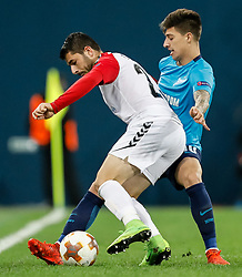 November 23, 2017 - Saint Petersburg, Russia - Emiliano Rigoni (R) of FC Zenit Saint Petersburg and Besir Demiri of FK Vardar vie for the ball during the UEFA Europa League Group L match between FC Zenit St. Petersburg and FK Vardar at Saint Petersburg Stadium on November 23, 2017 in Saint Petersburg, Russia. (Credit Image: © Mike Kireev/NurPhoto via ZUMA Press)