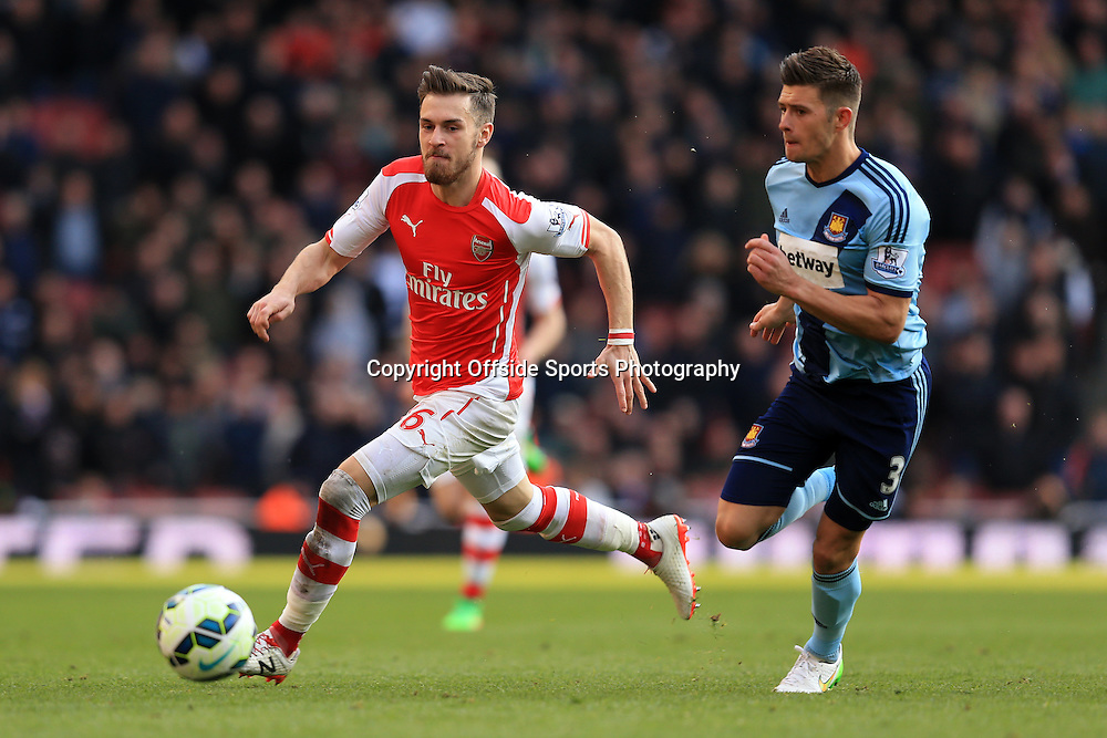 14 March 2015 - Barclays Premier League - Arsenal v West Ham - Aaron Ramsey of Arsenal in action with Aaron Cresswell of West Ham - Photo: Marc Atkins / Offside.