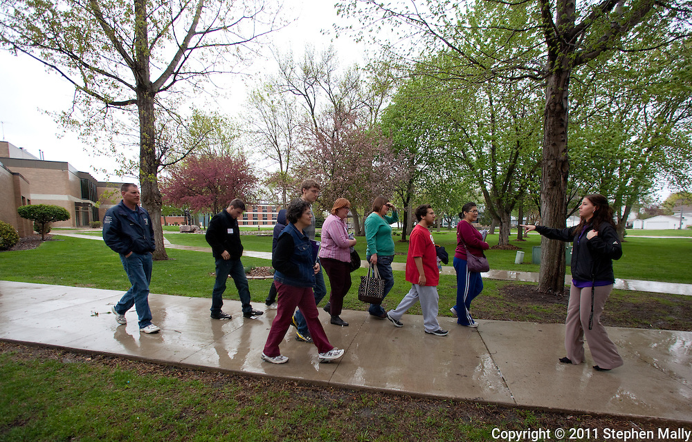 Trinity Renchin, student ambassador, leads a tour of prospective students and their parents during an open house at Waldorf College in Forest City, Iowa on Saturday, May 14, 2011.