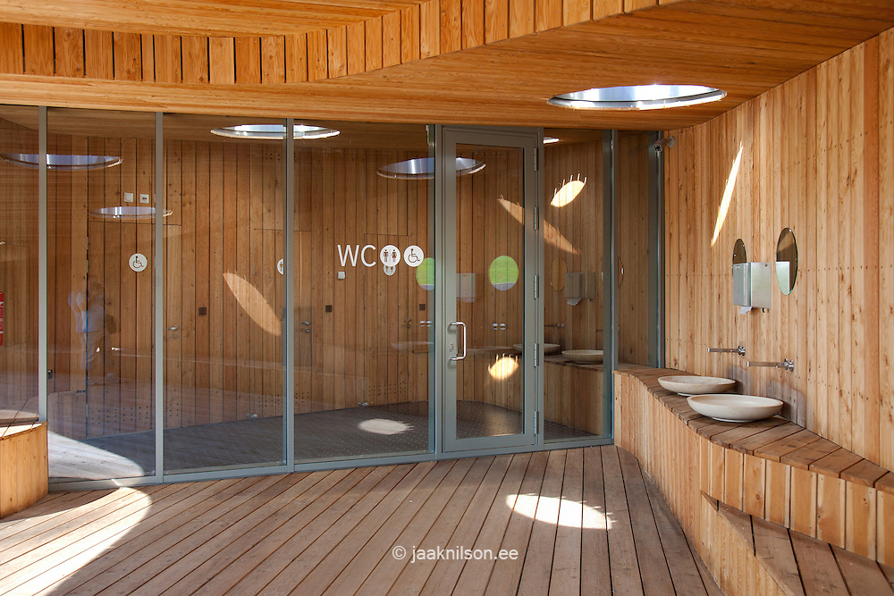 Restrooms, sink with glass doors, rest area with wooden floor and paneling in Estonian Road Museum
