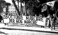 Roma 28 Ottobre 1999  .Il  Partito di estrema destra  Forza Nuova commemora la  Marcia su Roma  e i martiri fascisti a piazza Venezia,.Rome October 28 th 1999  .The Party of extreme right Strength New commemorates the March on Rome and the fascist martyrs to Venice plaza..The banner reads: 28 October....march not rotted! .