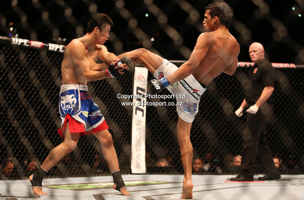 Brazilian Charles Oliviera, right,  beats Hatsu Kioki during the UFC Ultimate Fighting Championship fight night held at Vector Arena in Auckland on Saturday 28th of July 2014. <br /> Credit; Peter Meecham/ www.photosport.co.nz