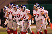 OAKLAND, CA - DECEMBER 31:  The New York Giants offensive line breaks the huddle against the Oakland Raiders at McAfee Coliseum on December 31, 2005 in Oakland, California. The Giants defeated the Raiders 30-21. ©Paul Anthony Spinelli