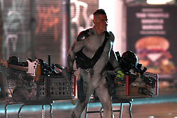 Josh Brolin pushes shopping carts out of Army & Navy filming Deadpool 2, dressed as Cable. Josh was seen filming scenes dressed as Cable in downtown, Vancouver. The sequel has been filming all summer and is coming to a close. Josh arrived on set and appeared to be giving art direction as he held his hands up to frame the light, while wearing his tight grey costume. Josh then filmed scenes where he appeared to steal 2 shopping carts from old navy and he loaded the into a van. Josh was seen getting his make up done on set as well as laughing and chatting to crew during the night shot. 03 Oct 2017 Pictured: Josh Brolin. Photo credit: Atlantic Images/ MEGA TheMegaAgency.com +1 888 505 6342
