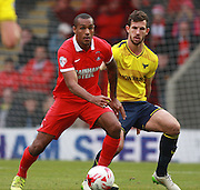 Leyton Orient striker Jay Simpson shields the ball from Oxford defender Jake Wright during the Sky Bet League 2 match between Leyton Orient and Oxford United at the Matchroom Stadium, London, England on 17 October 2015. Photo by Bennett Dean.