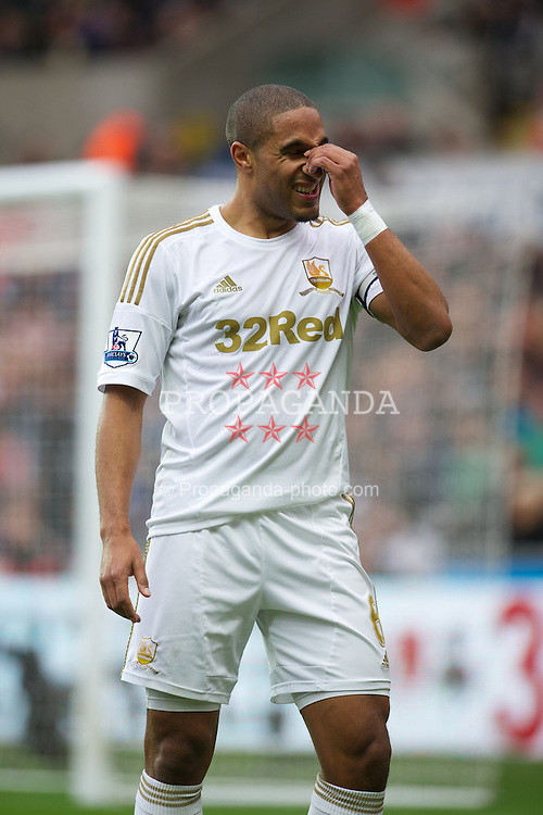 SWANSEA, WALES - Sunday, December 23, 2012: Swansea City's captain Ashley Williams in action against Manchester United during the Premiership match at the Liberty Stadium. (Pic by David Rawcliffe/Propaganda)