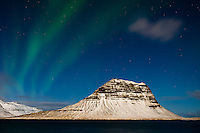 GRUNDARFJOROUR, ICELAND - CIRCA MARCH 2015: Aurora Borealis, also known as Northern Lights over the Kirkjufell mountain near Grundarfjordur, a landmark in the Snaefellsness Peninsula.