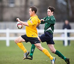 Edinburgh City&rsquo;s John Dun  and Edinburgh University&rsquo;s Paul Sutherland. <br /> Edinburgh University 0 v 1 Edinburgh City, Scottish Sun Lowland League game played 14/3/2015 at The University of Edinburgh&rsquo;s Peffermill playing field.