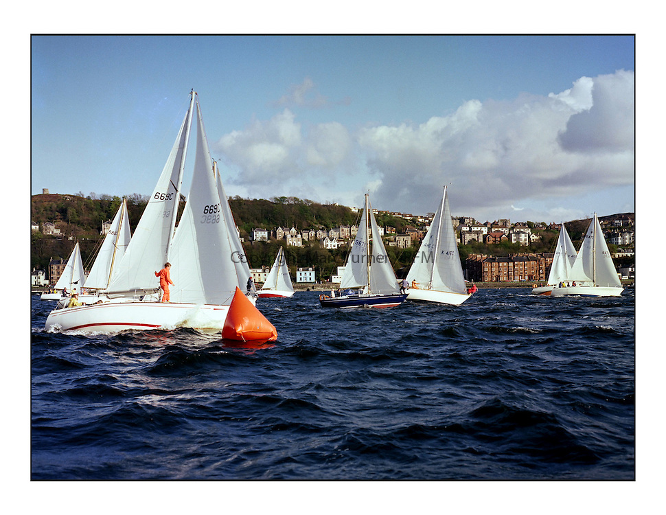 The Clyde Cruising Club's 1977 Tomatin Trophy the first Scottish Series held at Tarbert Loch Fyne.  An overnight race from Gourock to Campbeltown then on to Olympic Triangles in Loch Fyne. ..The start of the overnight race at Gourock.
