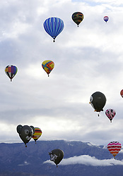 October 9, 2018 - Albuquerque, New Mexico, U.S. - Balloons fly against the  backdrop of the cloud covered Sandias during Tuesday's Mass Ascension at the Balloon Fiesta Park. (Credit Image: © Adolphe Pierre-Louis/Albuquerque Journal via ZUMA Wire)