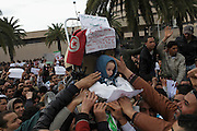 Protesters under the building of Constitutional Democratic Rally, RCD, party of Ben Ali, ask that the sign is removed.