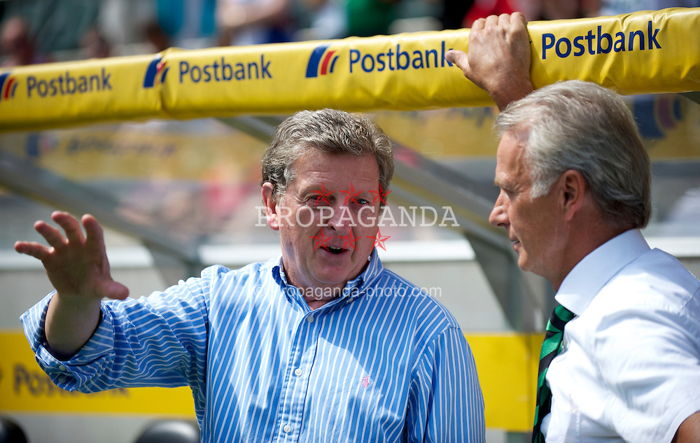 MONCHENGLADBACH, GERMANY - Sunday, August 1, 2010: Liverpool's manager Roy Hodgson with Borussia Monchengladbach's vice-president Rainer Bonhof before a preseason friendly match at Borussia-Park. (Pic by David Rawcliffe/Propaganda)