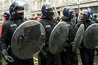 Riot policemen surrounding group of protesters on Mayday, London.