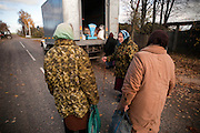 Pensioned women wait to buy basic groceries from a mobile market in the village of Ivanovka on Oct. 30. 2009. Many village residents are unable to travel to larger villages or towns to shop for basic household supplies and groceries, therefore once a week a truck drives to through the villages to sell goods.