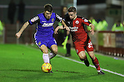 Mitch Hancox of Crawley Town battles for the ball during the Sky Bet League 2 match between Crawley Town and Stevenage at the Checkatrade.com Stadium, Crawley, England on 26 December 2015. Photo by Phil Duncan.