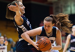 March 6 2016: Robert Morris Colonials forward Megan Smith (22) goes to the basket against Fairleigh Dickinson Lady Knights center Erika Livermore (23) during the second half in the NCAA Women's Basketball game between the Fairleigh Dickinson Lady Knights and the Robert Morris Colonials at the Charles L. Sewall Center in Moon Township, Pennsylvania (Photo by Justin Berl)
