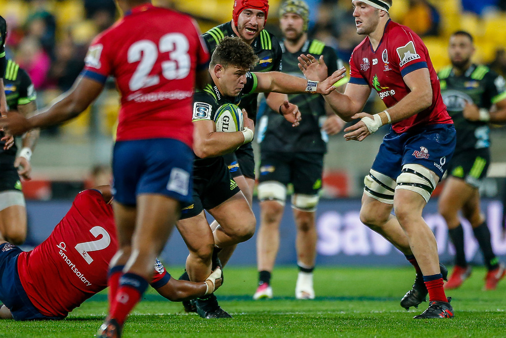 Ricky Riccitelli tackled by Brandon Paenga-Amosa during the Super rugby union game (Round 14) played between Hurricanes v Reds, on 18 May 2018, at Westpac Stadium, Wellington, New  Zealand.    Hurricanes won 38-34.