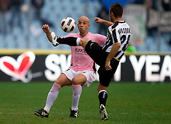 Giulio Migliaccio of Plaermo vs  Giovanni Pasquale of Udinese during football match between Udinese Calcio and Palermo in 8th Round of Italian Seria A league, on October 24, 2010 at Stadium Friuli, Udine, Italy.  Udinese defeated Palermo 2 - 1. (Photo By Vid Ponikvar / Sportida.com)