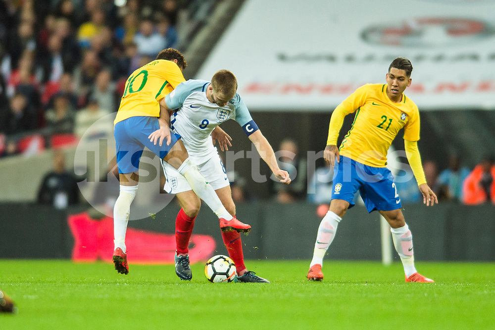 Eric Dier of England holds off a challenge from Neymar jr of Brazil during the international friendly match between England and Brazil at Wembley Stadium, London, England on 14 November 2017. Photo by Darren Musgrove.