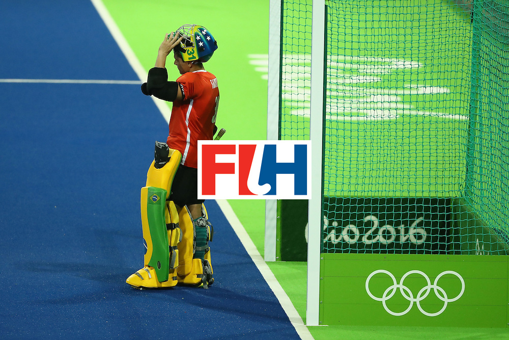 RIO DE JANEIRO, BRAZIL - AUGUST 12:  Rodrigo Faustino #31 of Brazil lifts his helmet against Australia during a Men's Preliminary Pool B match on Day 7 of the Rio 2016 Olympic Games at the Olympic Hockey Centre on August 12, 2016 in Rio de Janeiro, Brazil.  (Photo by Sean M. Haffey/Getty Images)