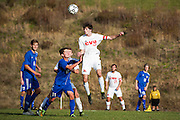 CVU's Cooper O'Connell (10) leaps over Mt. Anthony's Franklin Cody (11) during the boys semifinal soccer game between Mount Anthony and Champlain Valley Union at CVU high school on Tuesday afternoon October 27, 2015 in Hinesburg. (BRIAN JENKINS/ for the FREE PRESS)