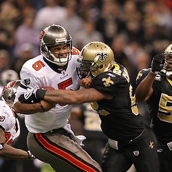 Dec 27, 2009; New Orleans, LA, USA; New Orleans Saints linebacker Jonathan Casillas (52) and linebacker Jonathan Vilma (51) pressure Tampa Bay Buccaneers quarterback Josh Freeman (5) during the second quarter at the Louisiana Superdome. Mandatory Credit: Derick E. Hingle-US PRESSWIRE..