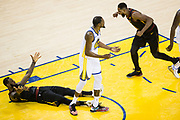 Cleveland Cavaliers forward LeBron James (23) celebrates a charge called against Golden State Warriors forward Kevin Durant (35) during Game 1 of the NBA Finals at Oracle Arena in Oakland, Calif., on May 31, 2018. The call would later be overturned. (Stan Olszewski/Special to S.F. Examiner)