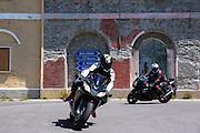 Motorcyclists drive The Stelvio Pass, Passo dello Stelvio, Stilfser Joch, to Bormio, Northern Italy